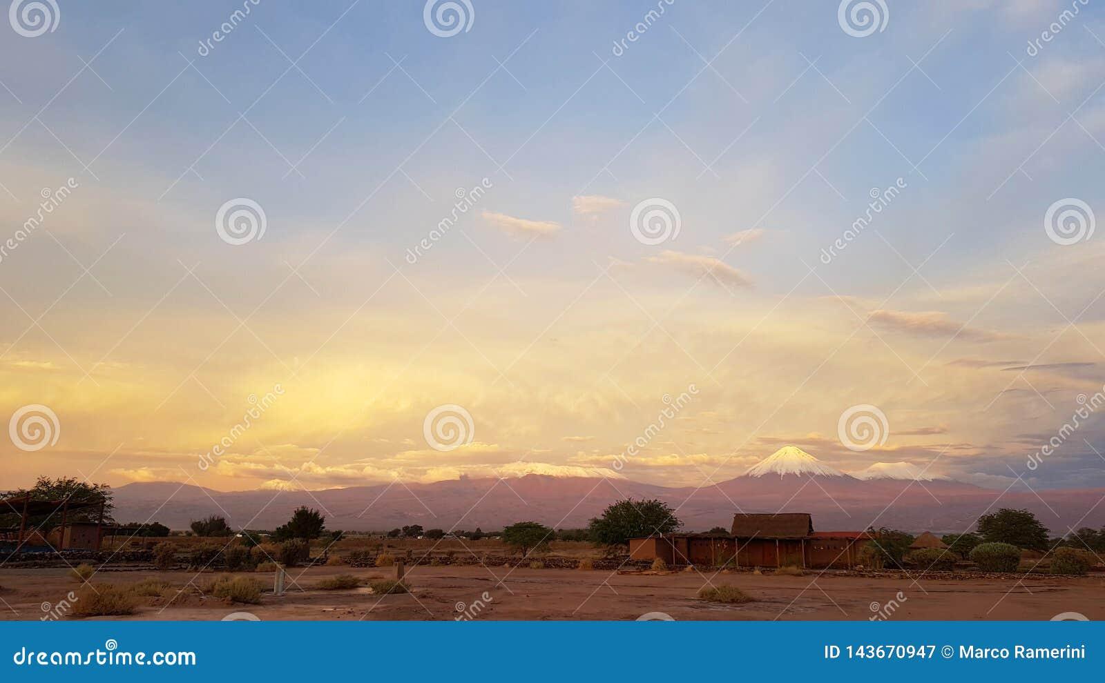 Sunset lights in the arid and desolate landscape of the Atacama Desert