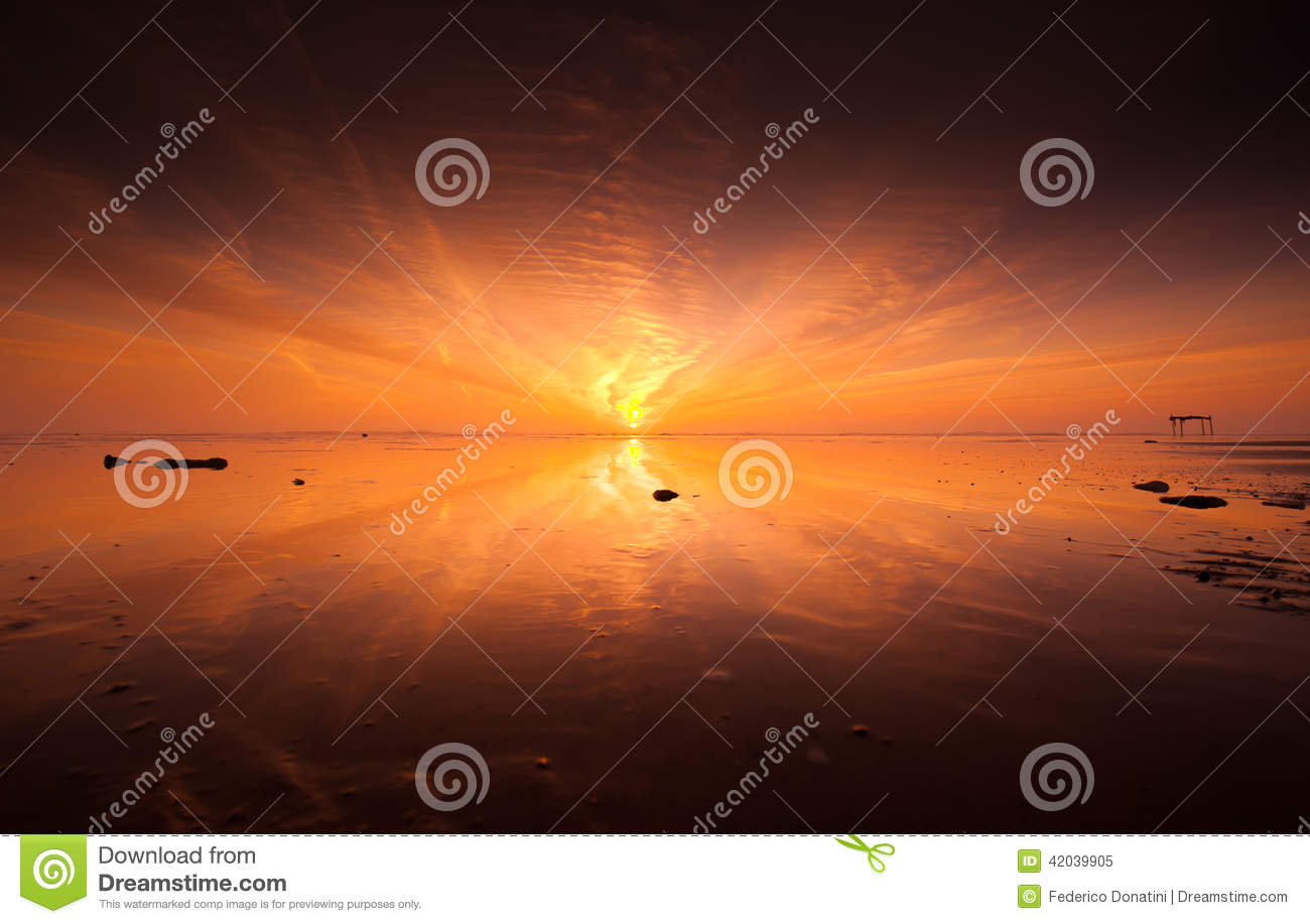 Sunset on lonely beach