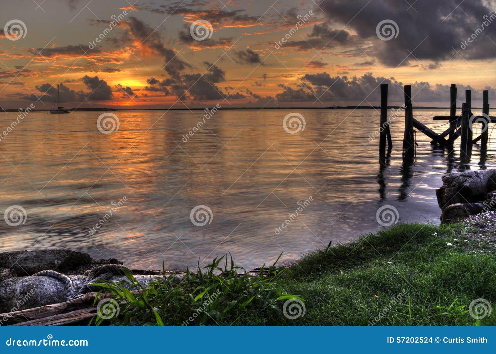 Sunset with piers Fernandina Beach Amelia Island Florida