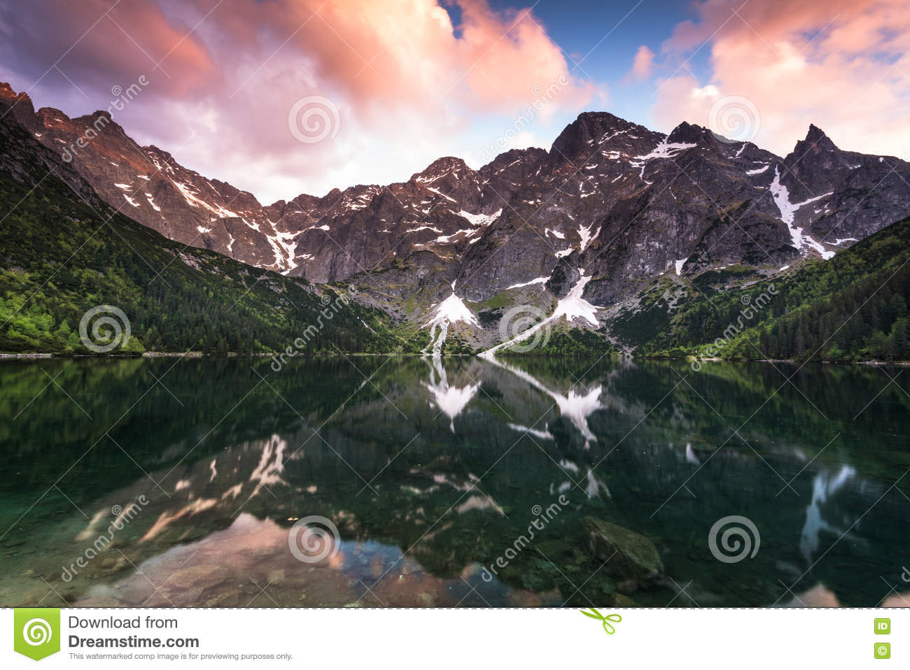 Sunset over alpine pond Morskie Oko in Poland
