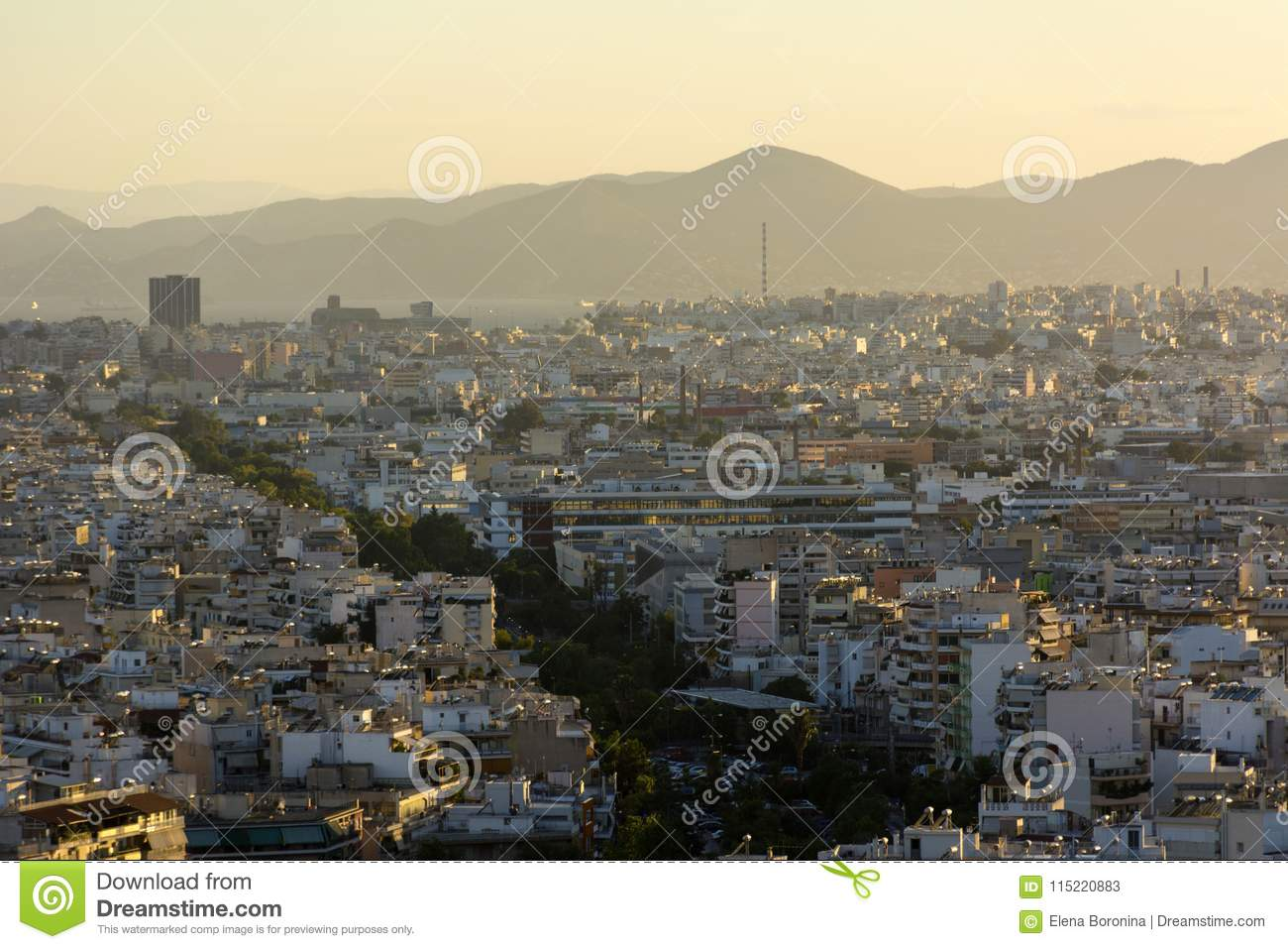 Sunset over the city, the city in the yellow sunlight, Athens