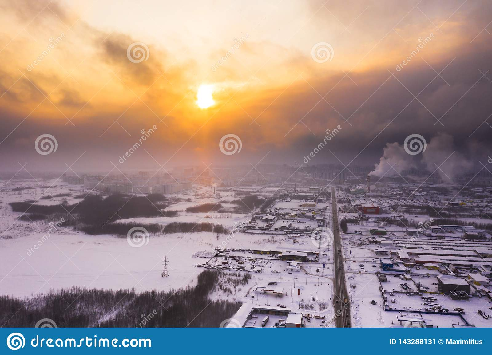 Sunset over the city in winter.