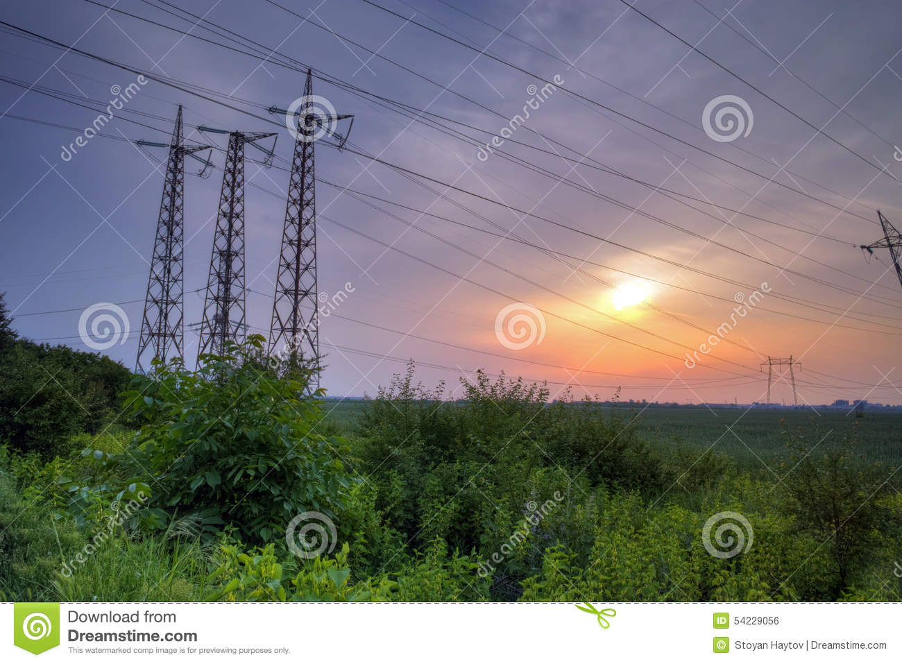 Sunset Over High-voltage Power Lines Stock Photo - Image ...