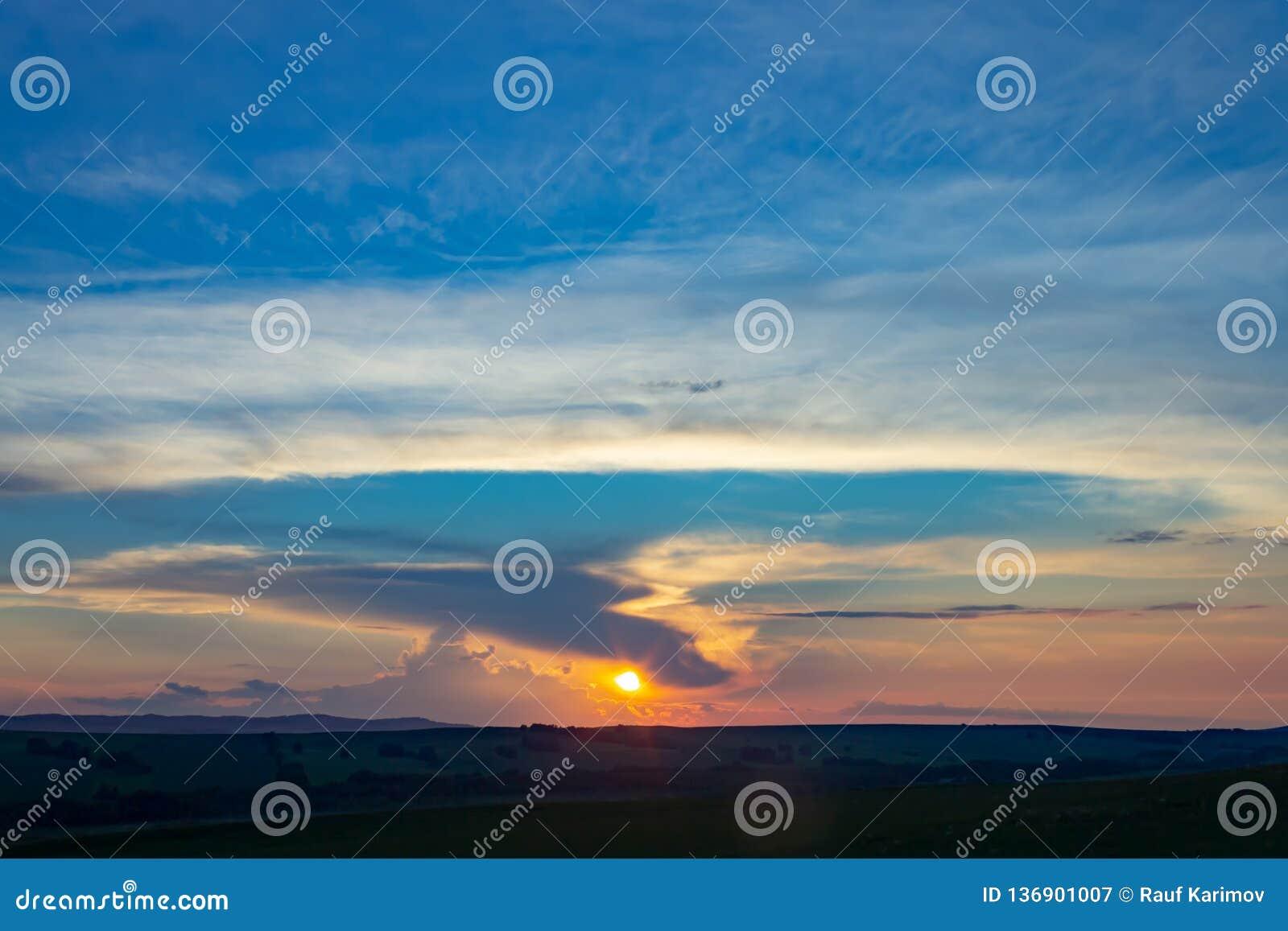 Sunset over the horizon against the blue sky