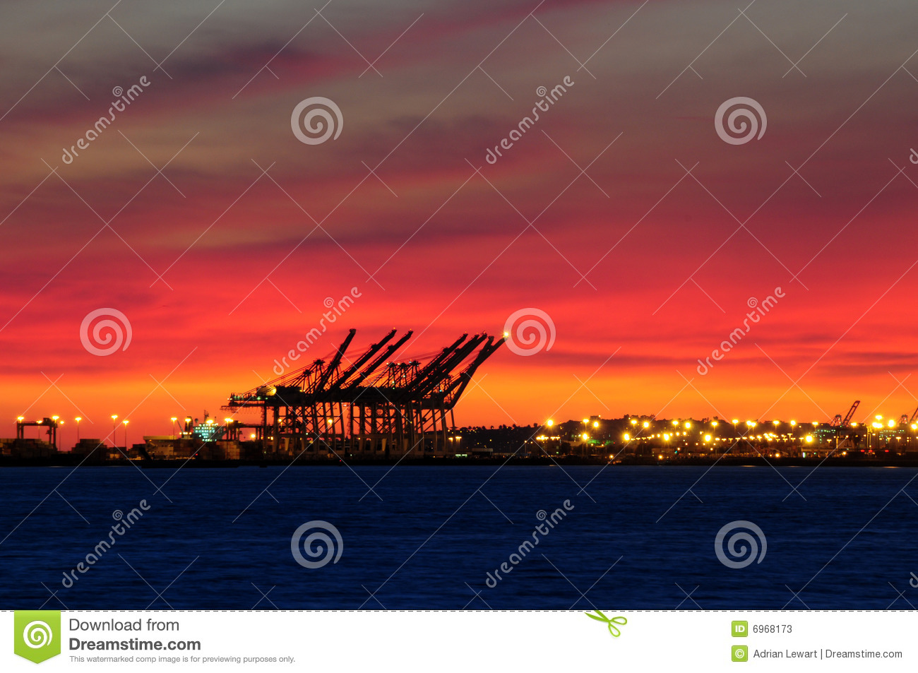 Sunset over industrial port