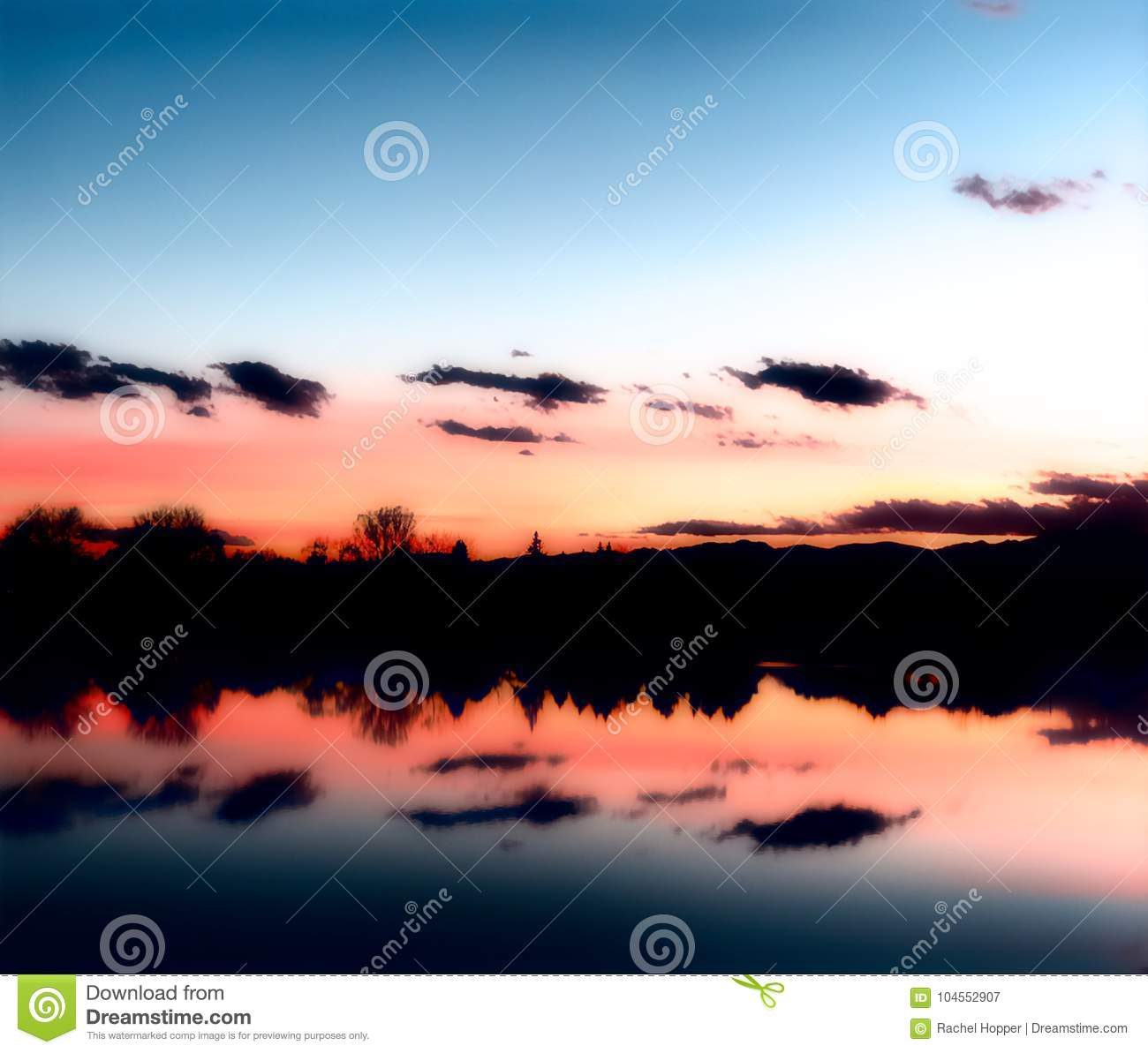Sunset over a Lake with Reflections in the Water