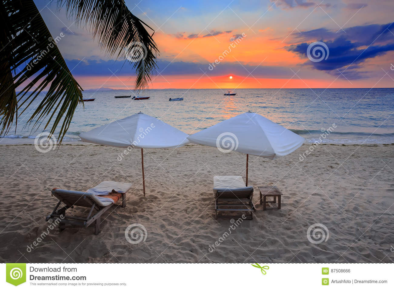 Sunset over Madagascar Nosy be beach with sunlounger