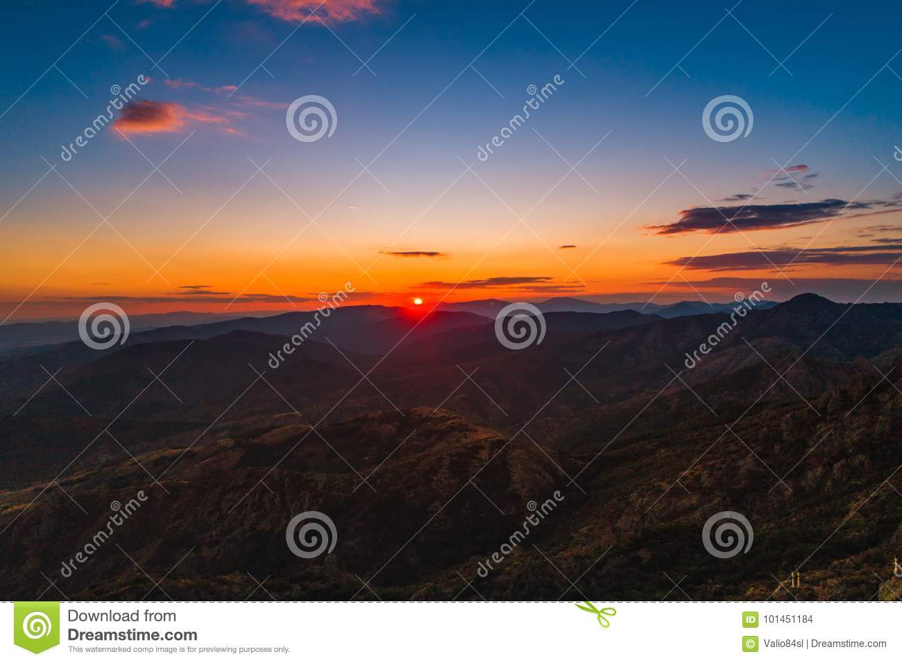Sunset over mountain hills, aerial panoramic view