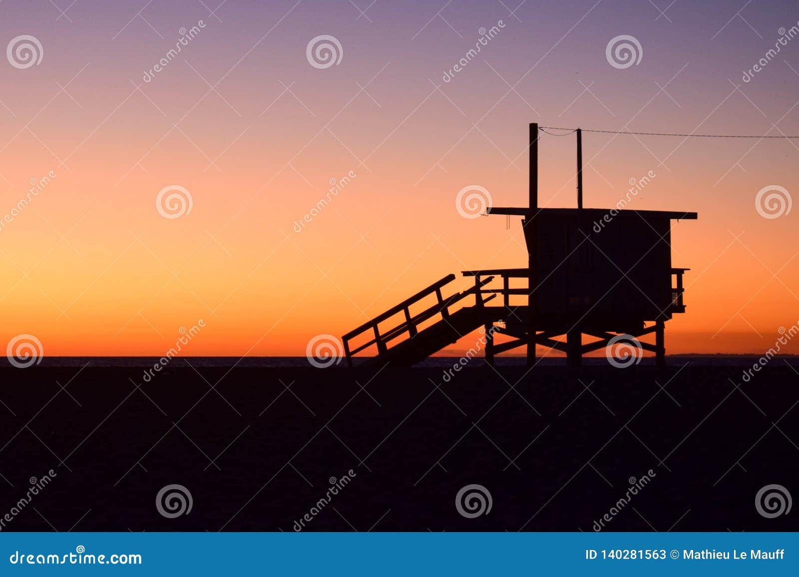 Sunset over USA Beach and Lifeguard Tower in Santa Monica, California