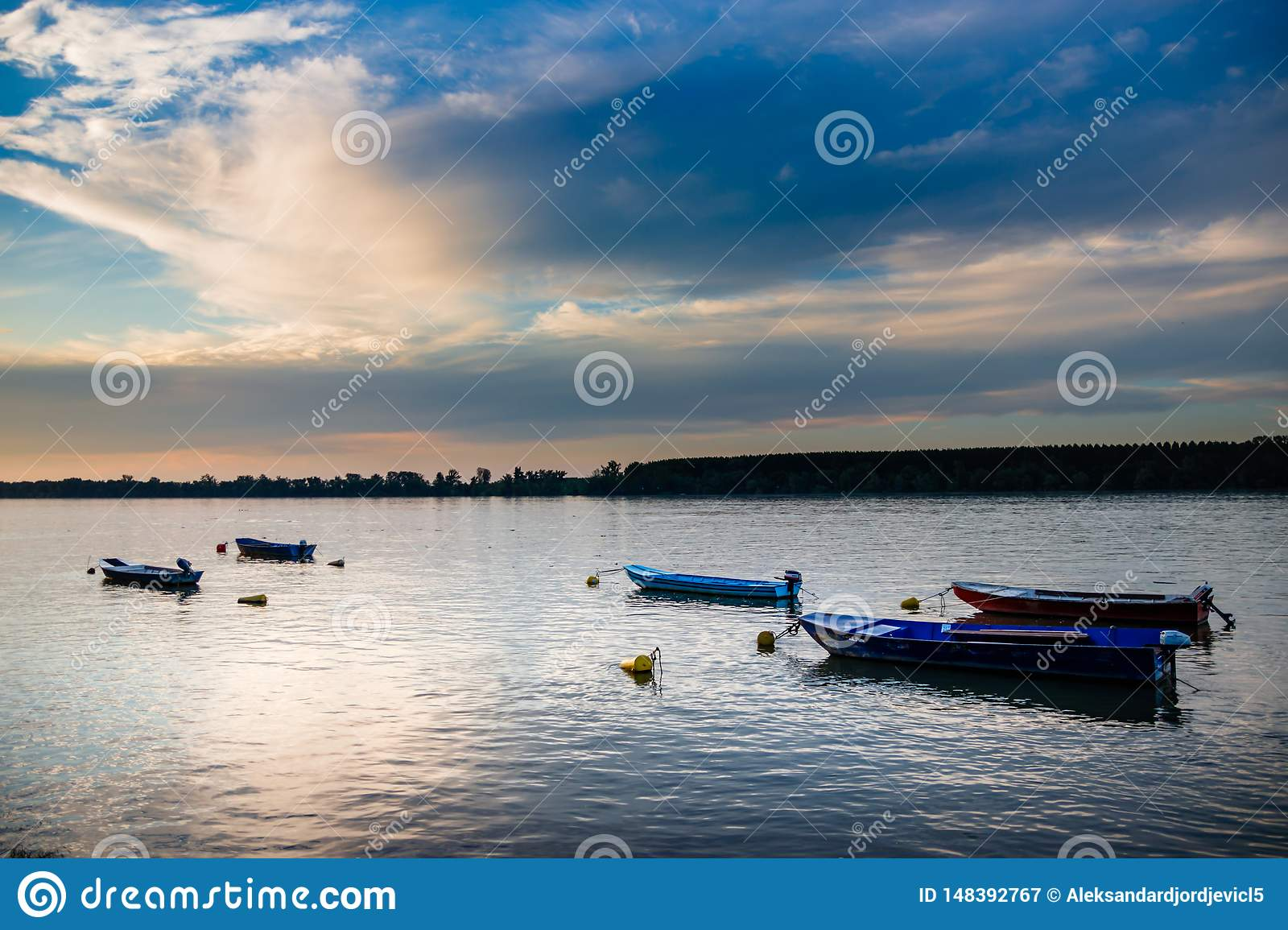 Sunset on river Danube with few boats