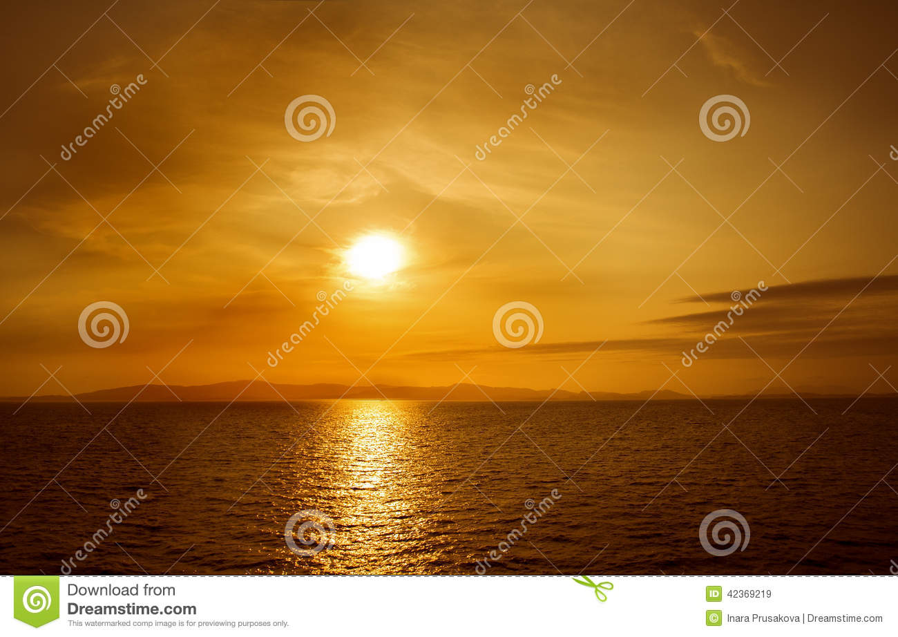 Sunset on sea. Bright sun on sky. beach landscape