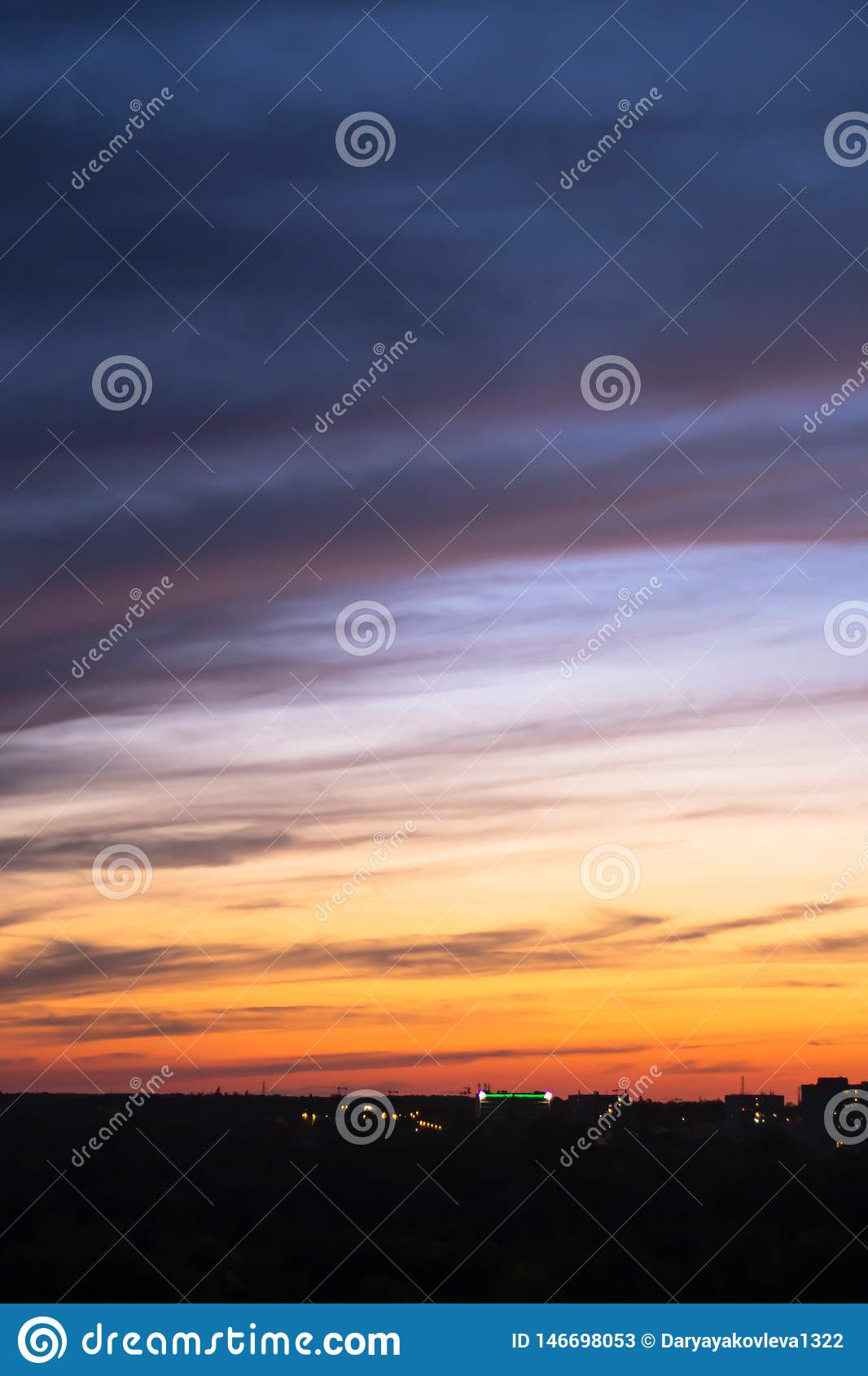 Sunset sky blue-orange colors with dramatic clouds