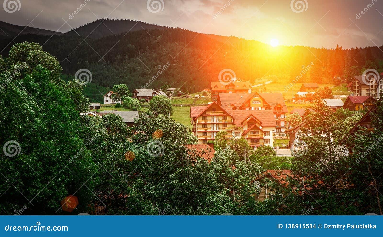 The sunset or sunrise , beautiful landscape, rice fields autumn near the village in the mountains, ukrainian carpathian mountains