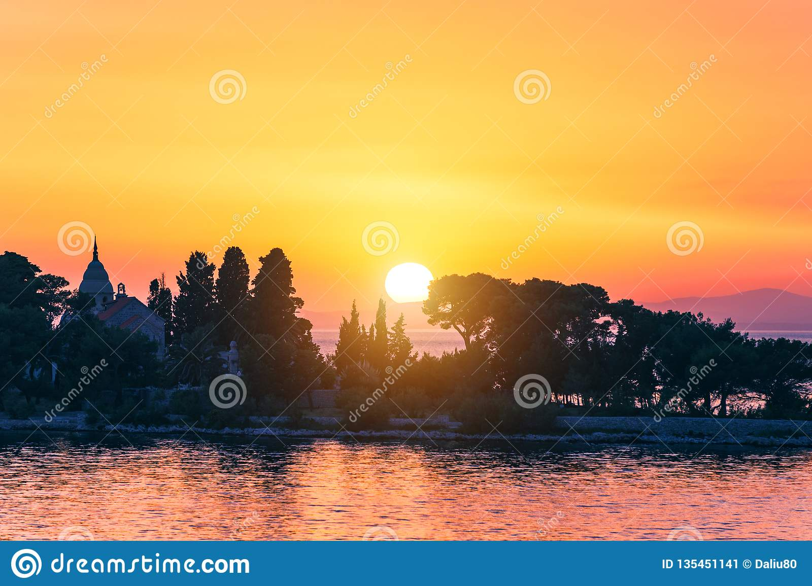 Sunset or sunrise sky above the sea. Nature, weather, atmosphere, travel theme. Sunrise or sunset over the sea. Panorama