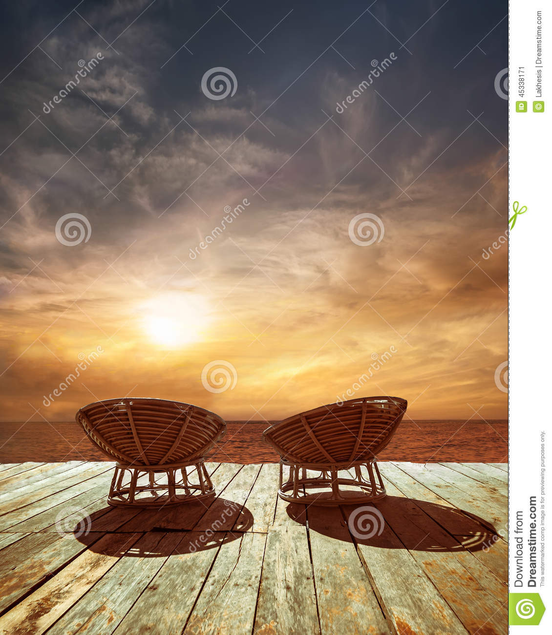 Sunset At Tropical Ocean Beach With Chairs For Relaxation