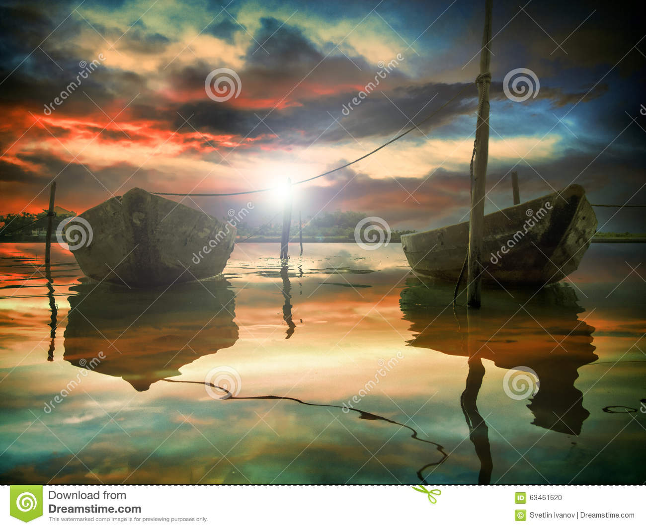 The sunset and two fishing boats