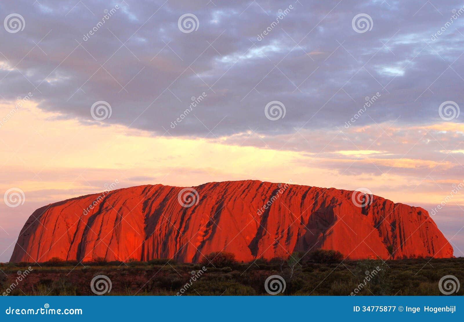 Uluru Ayers Rock (Unesco) is on fire at sunset, Australia