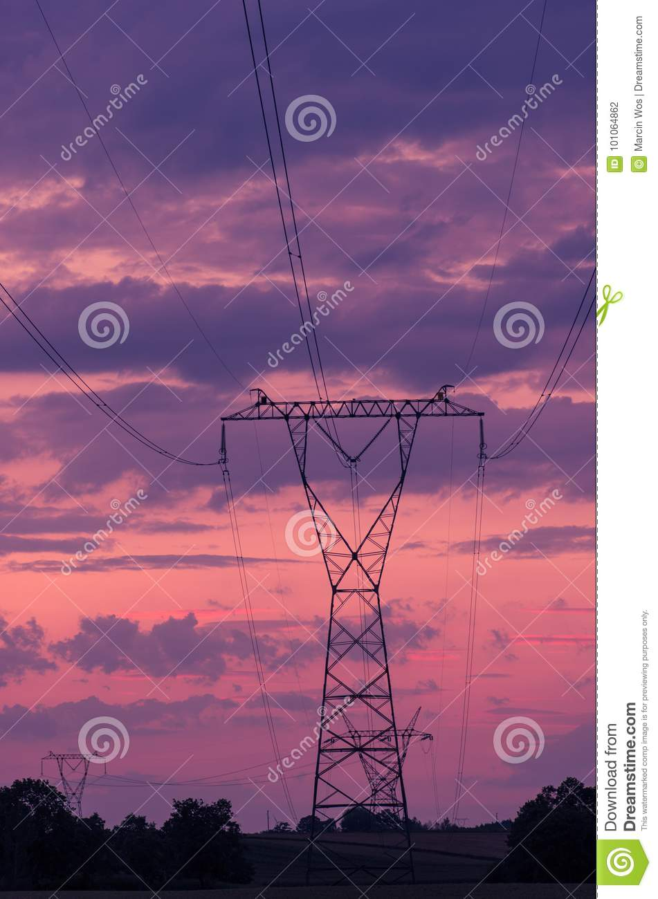 Sunset Under The High-voltage Tower In The Background  Stock