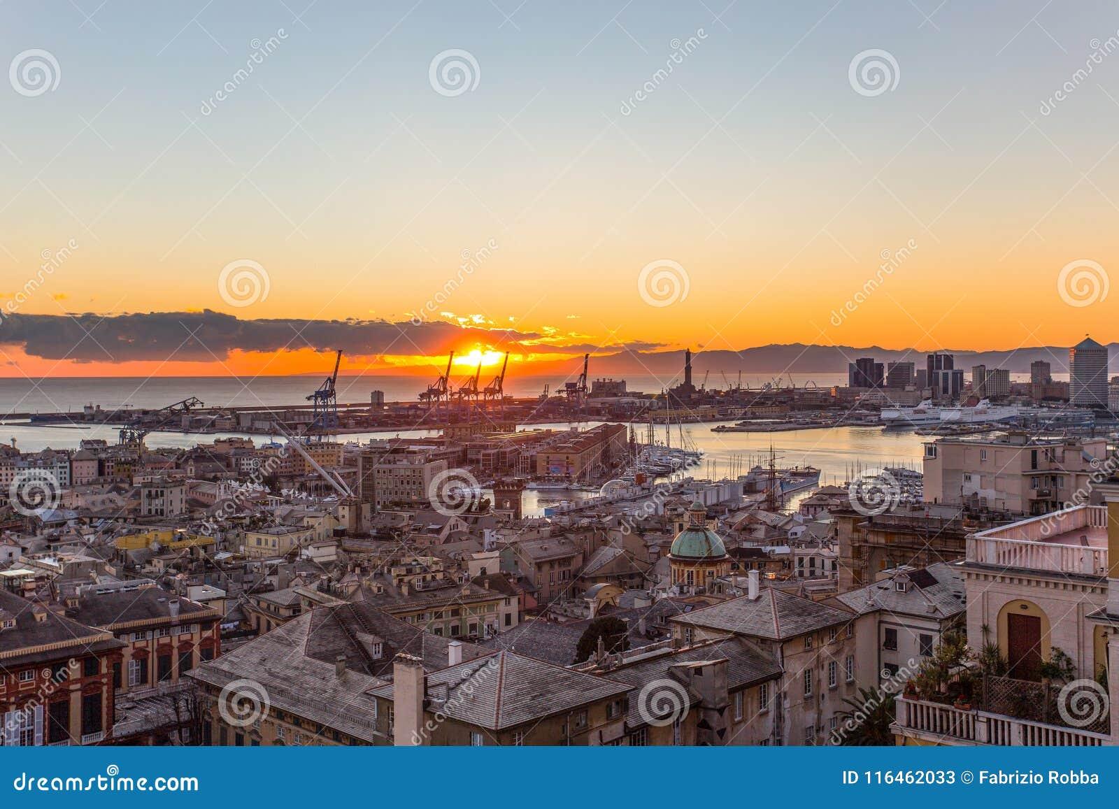Sunset view of the city of Genoa, Italy/ Genoa landscape/ Genoa Skyline/ city landscape/ aereal view/ light/ city light/ orange/ s