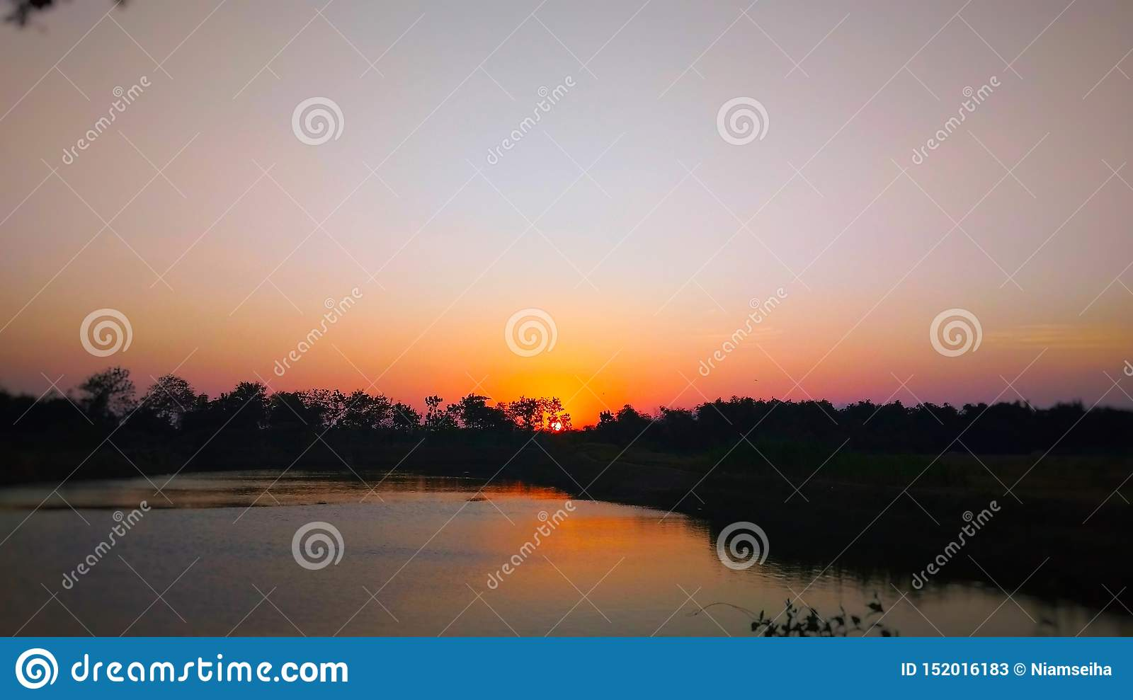 Sunset view on the edge of the reservoir
