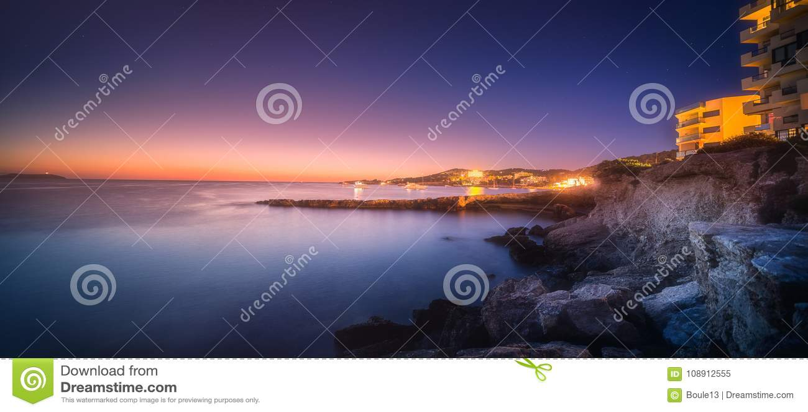 Sunset view of San Antonio beach and Ibiza, Spain
