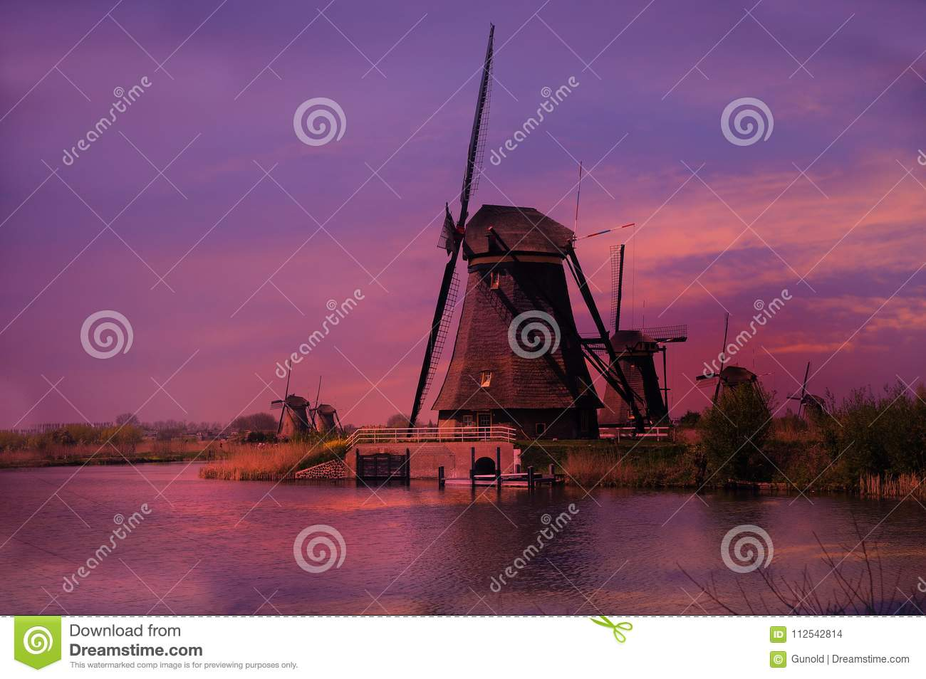 Sunset at the windmills in Kinderdijk in Netherlands
