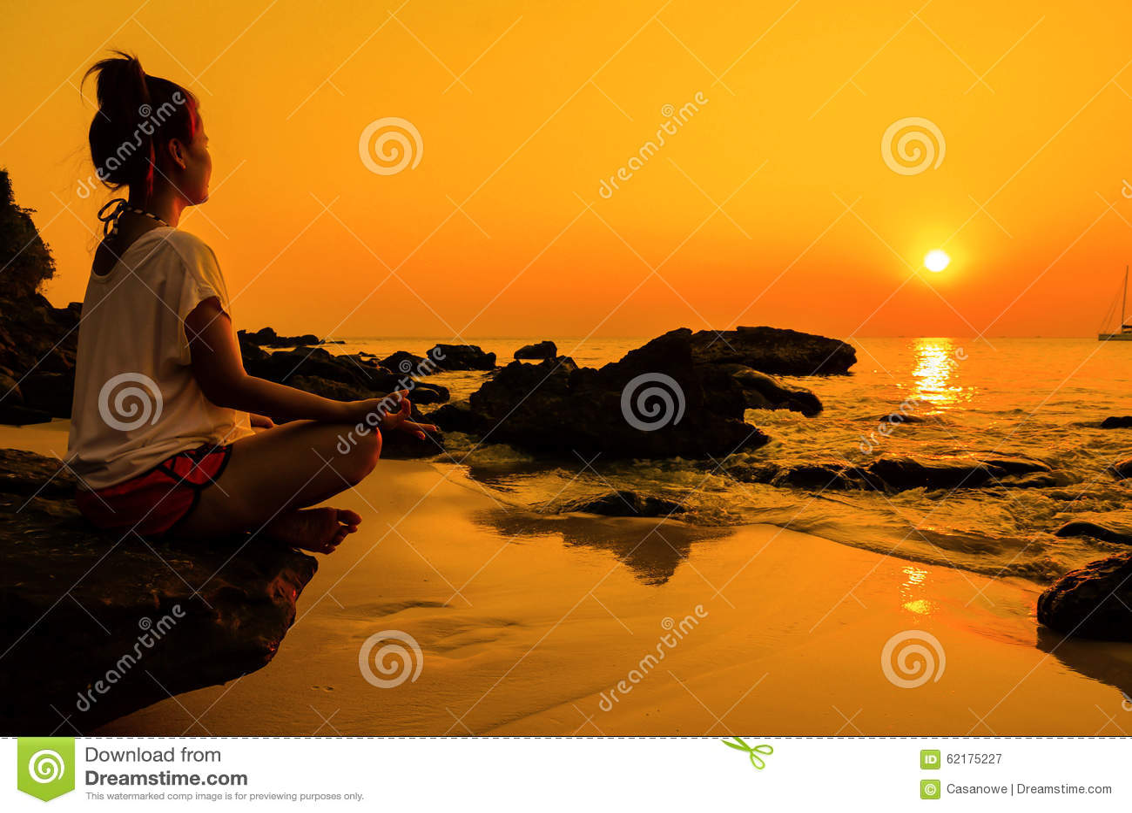 sunset yoga woman with spirituality on sea coast