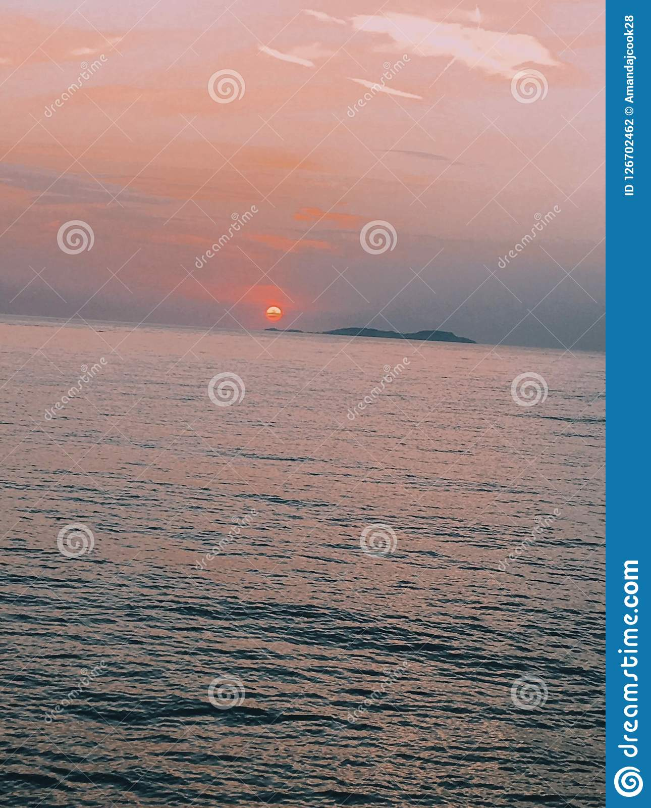 Sunsets and seas. Meet me where the sky touches the sea Stock Photography