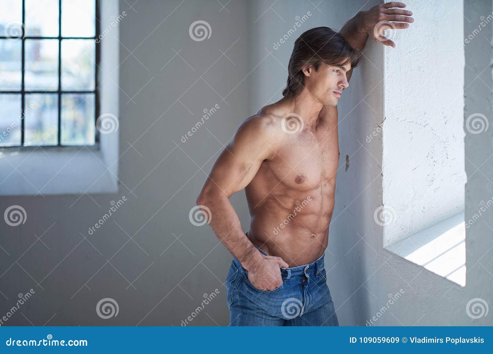 e8d65962 Portrait Of Suntanned Muscular Guy In Denim Jeans. Stock Image ...