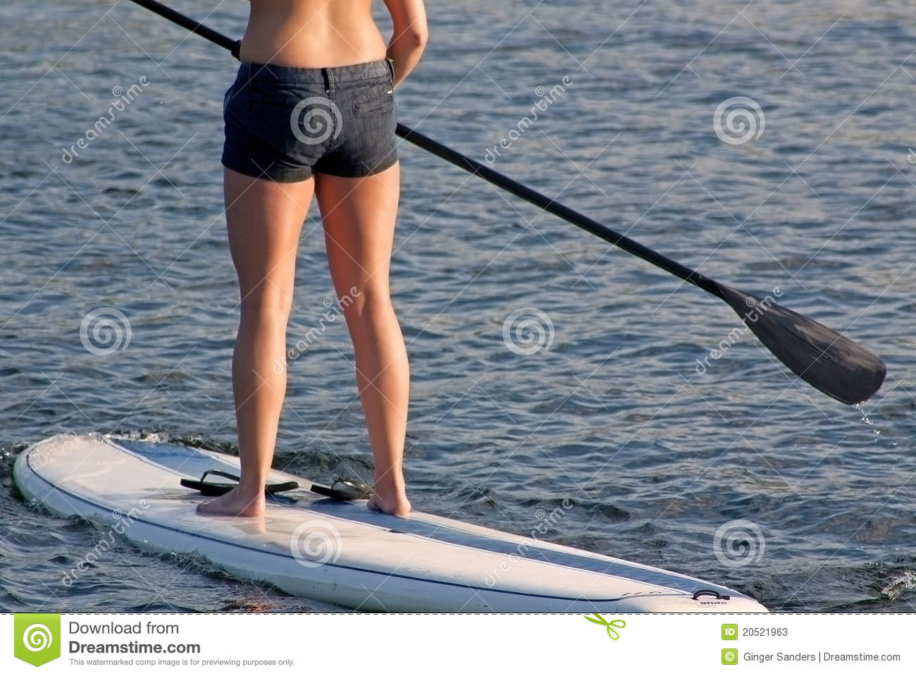 Suntanned Stand Up Paddle Boarder Woman