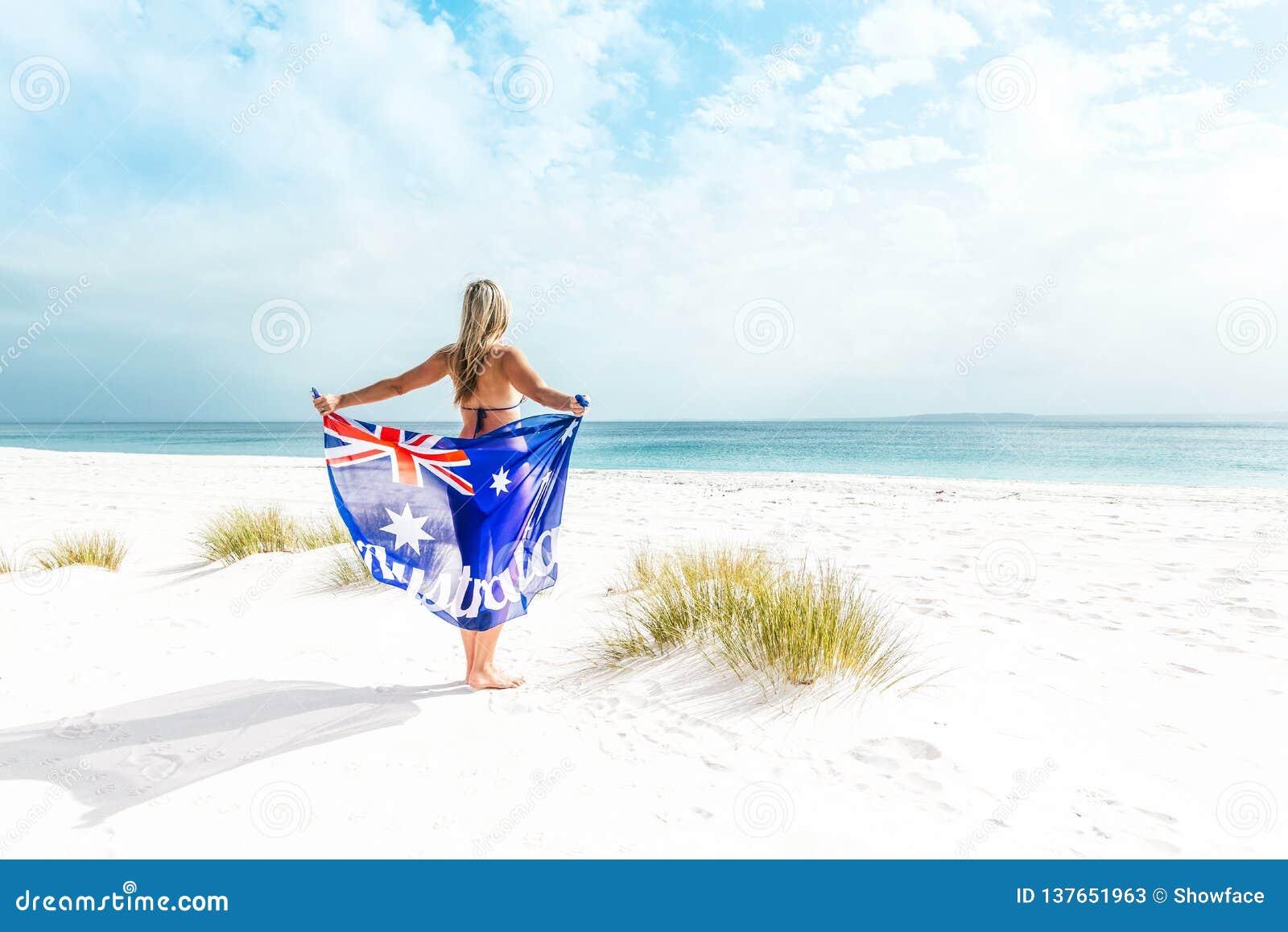 Suntanned woman on beautiful beach in Australia