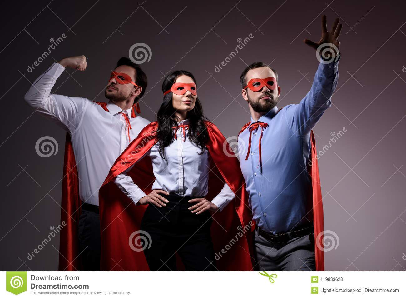 super businesspeople in masks and capes showing superpower