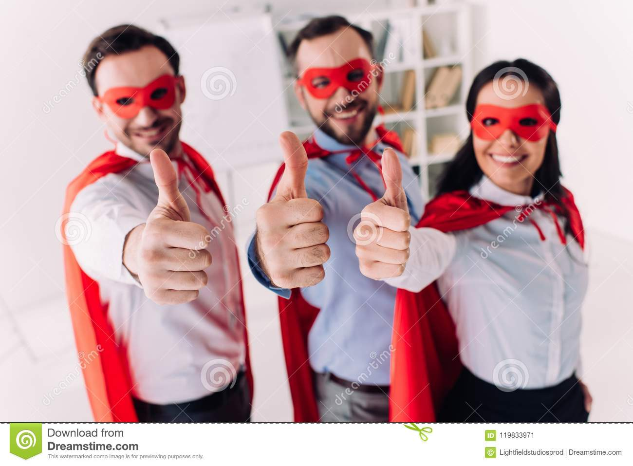 super businesspeople in masks and capes showing thumbs up