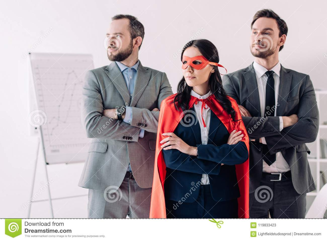 super businesswoman standing with crossed arms in mask and cape with businessmen