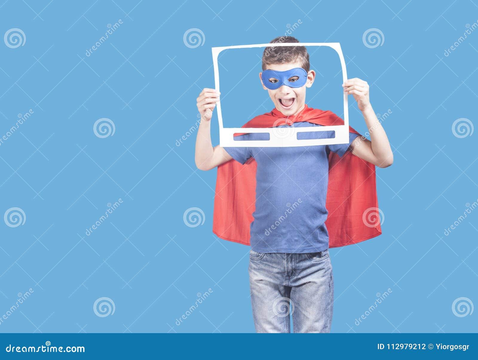 Super hero kid holding a paper TV frame