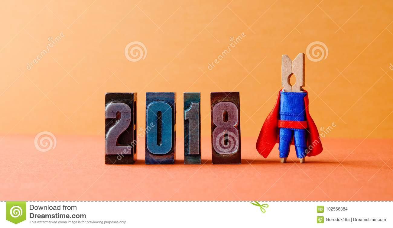 Super successful 2018 new year card. Brave superhero leader posing on vintage letterpress digits. Beautiful clothespin