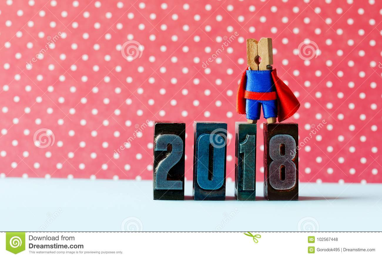 super successful 2018 new year card brave superhero leader posing on vintage letterpress digits