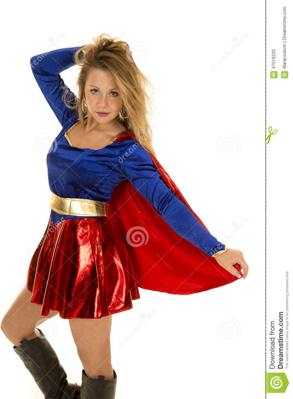 Super woman hold back cape hand in hair