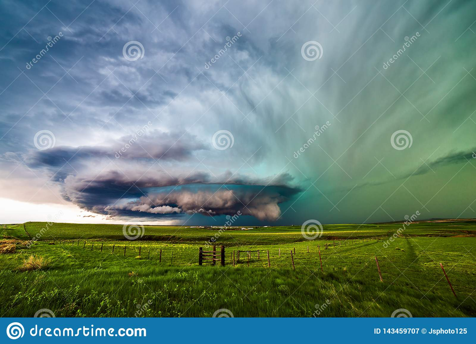 Supercell thunderstorm over a field