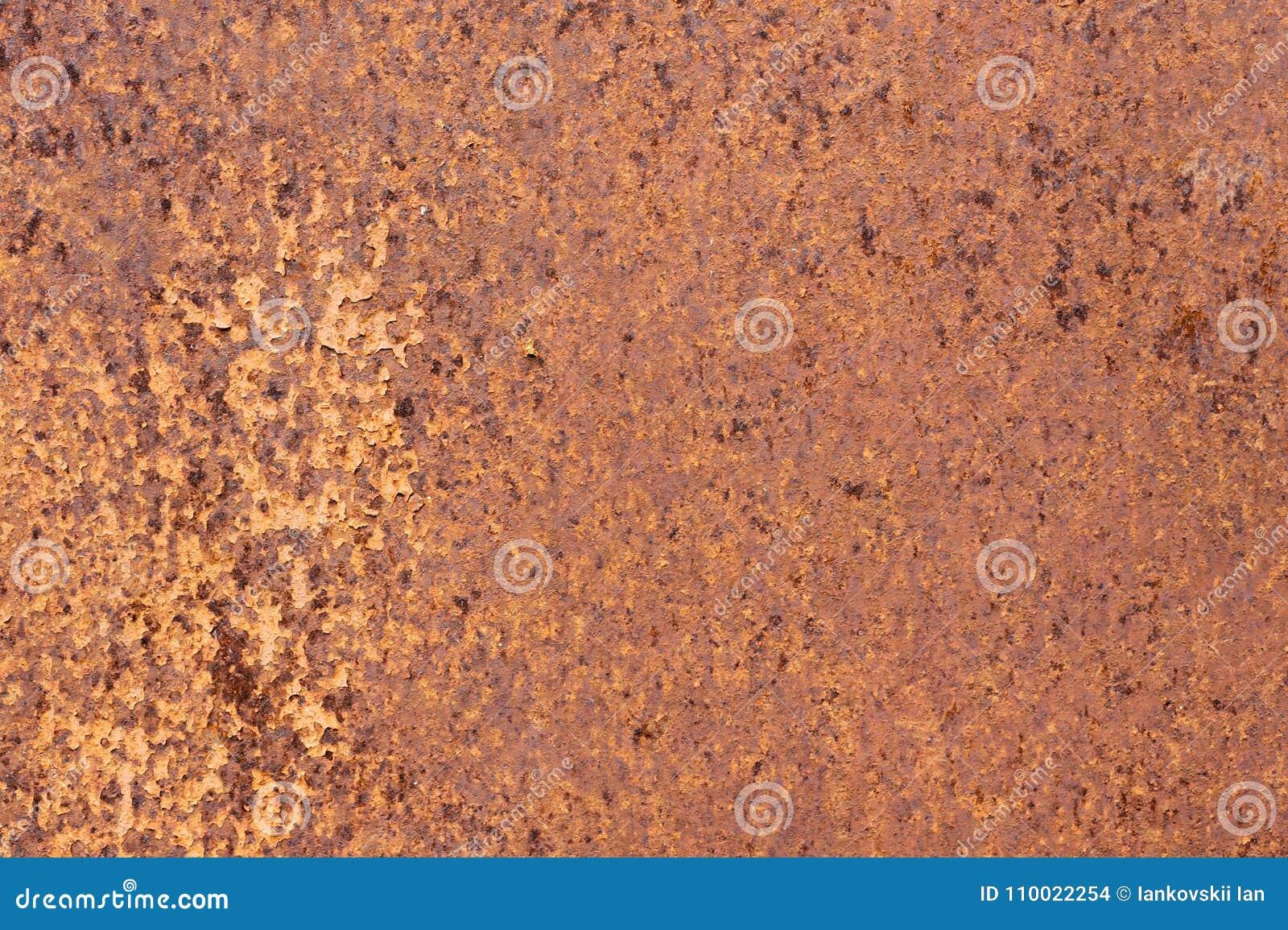 Superfície de metal textured amarelo-vermelha oxidada A textura da folha de metal é oxidação e corrosão inclinadas grunge