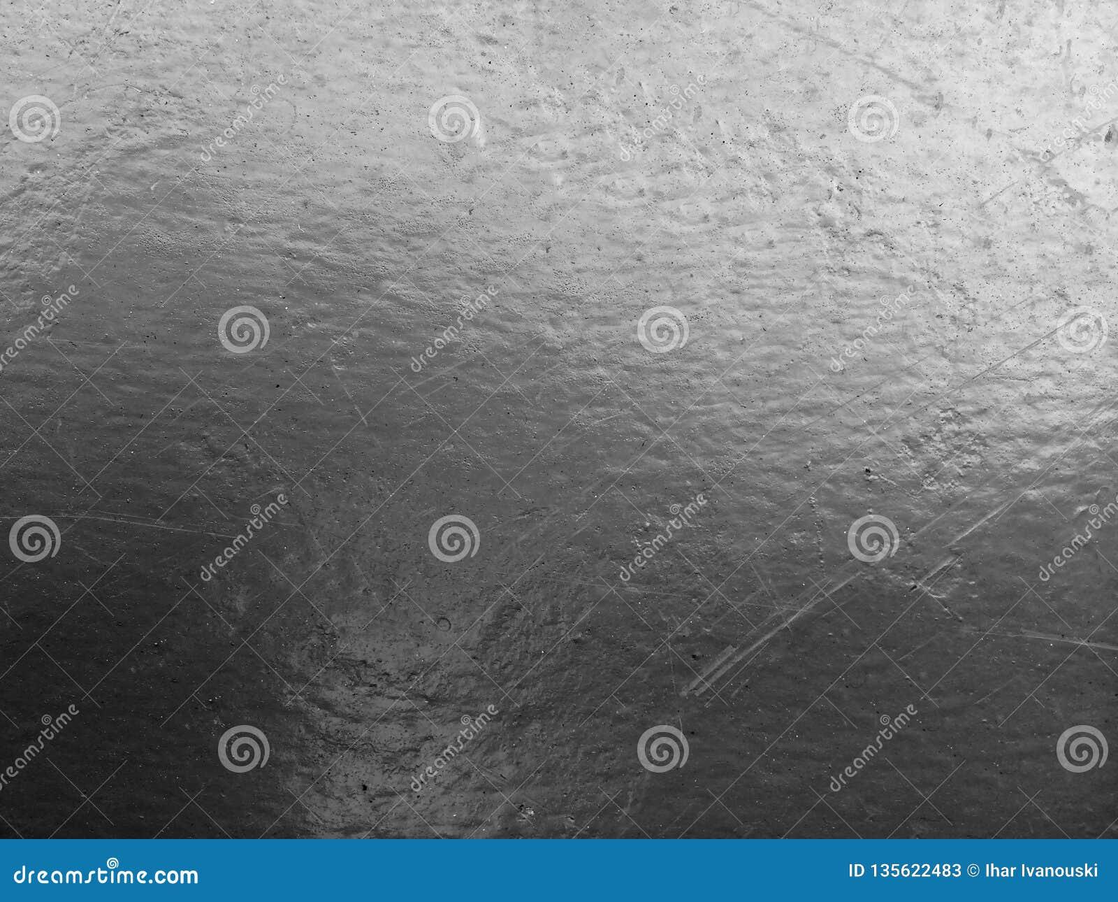 Superfície desigual áspera do muro de cimento velho com pintura cinzenta velha