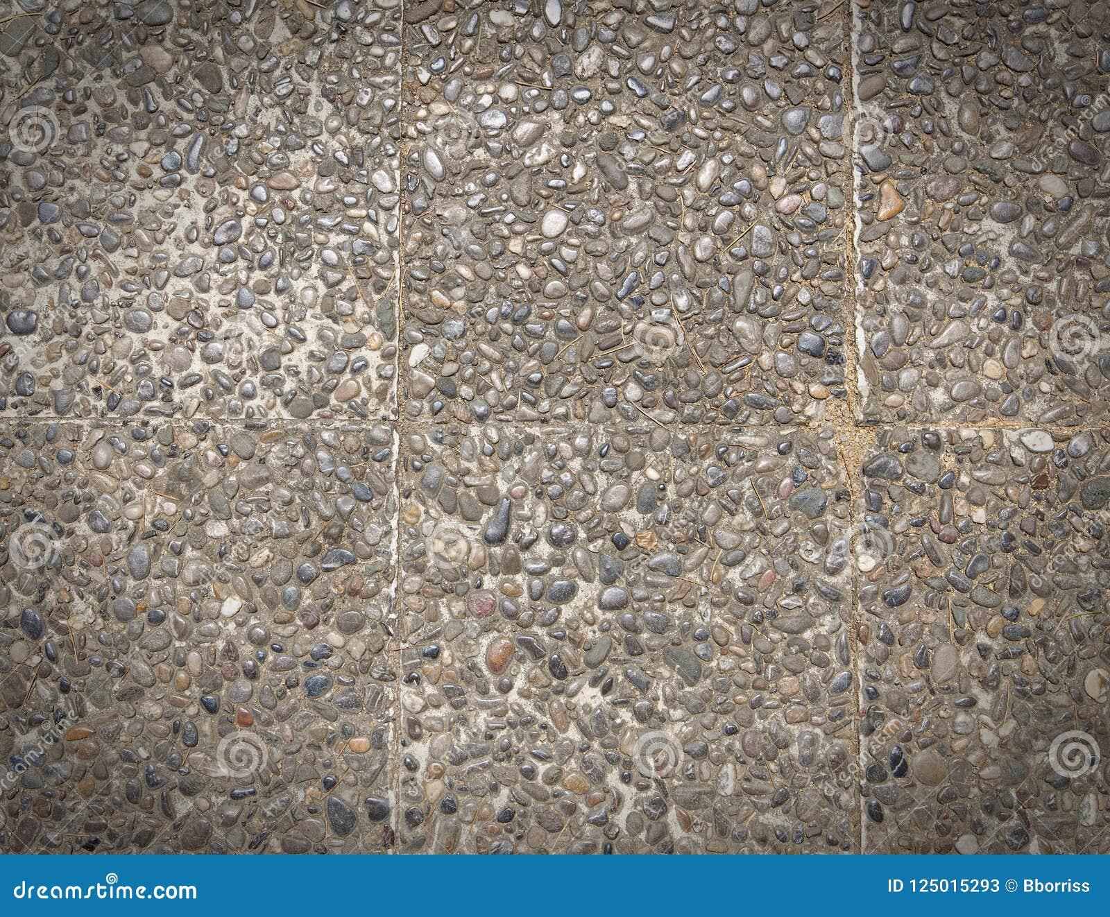 Superficie áspera del final global expuesto, de la textura piso lavado piedra de tierra, hecho de pequeña piedra de la arena en c