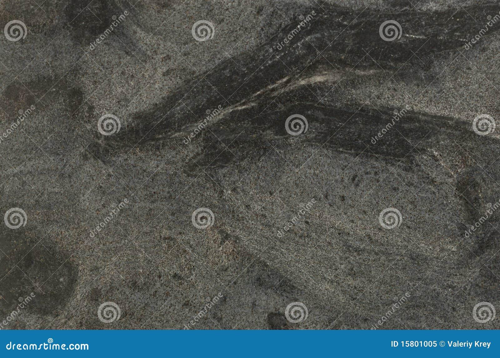 Superficie del granito colores negros y grises foto de for Piedra granito colores
