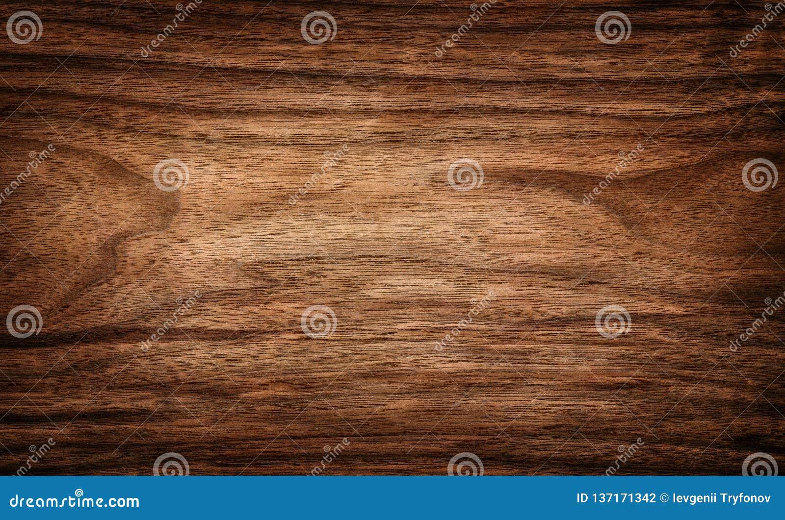 Superficie di legno scura del fondo di struttura con il modello naturale