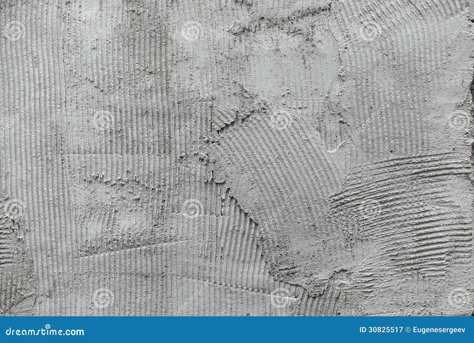 Superficie grigia del pettine del gesso della colla della parete