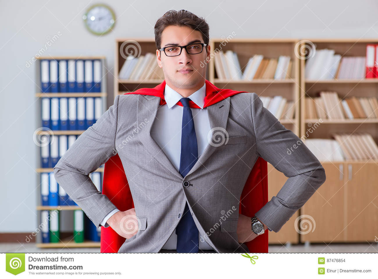 The superhero businessman working in the office