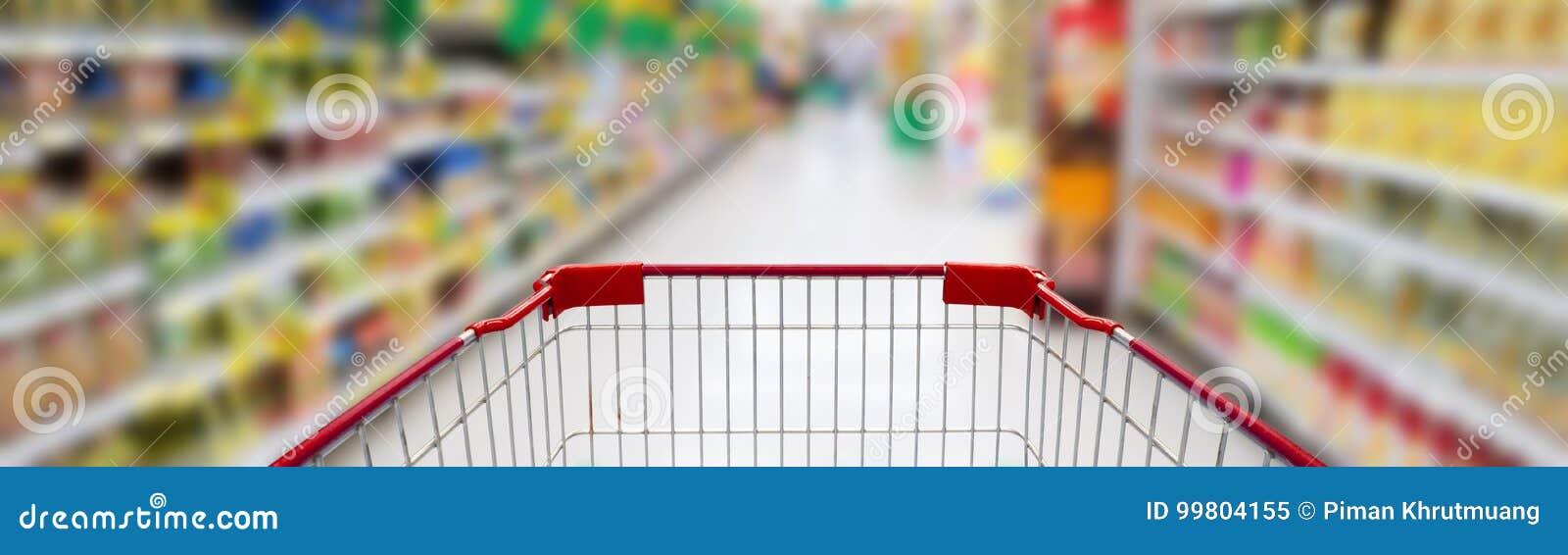 Supermarket nawa z pustym czerwonym wózek na zakupy