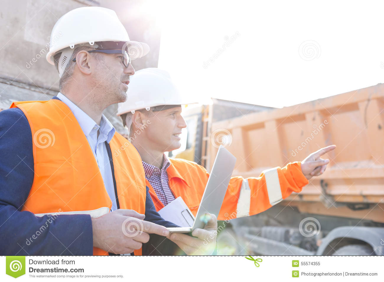supervisor with construction hard hat and high visibility
