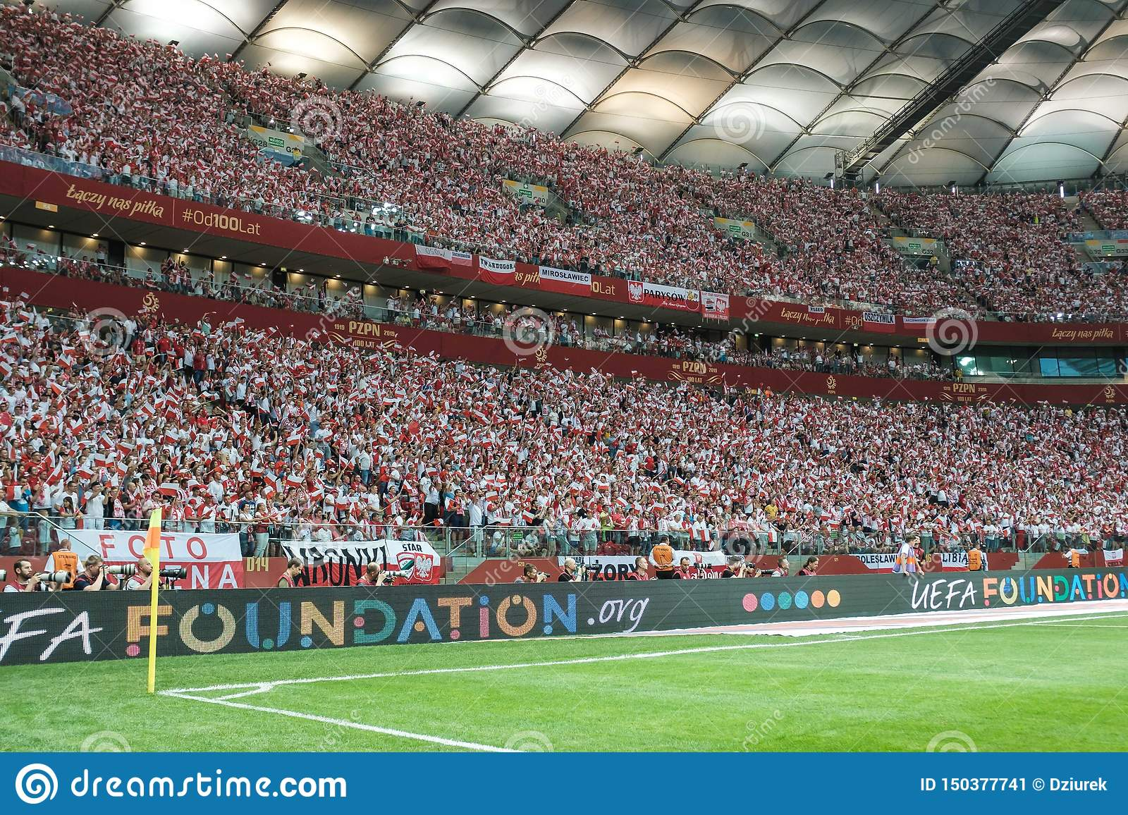 Supporters Of Poland With The Small National Flags Editorial