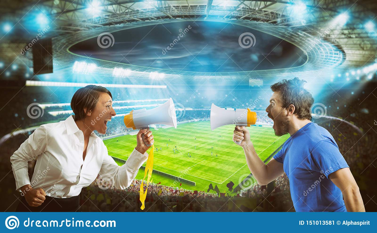 Supporters of opposing teams shout against each other with a megaphone at the stadium during a football match